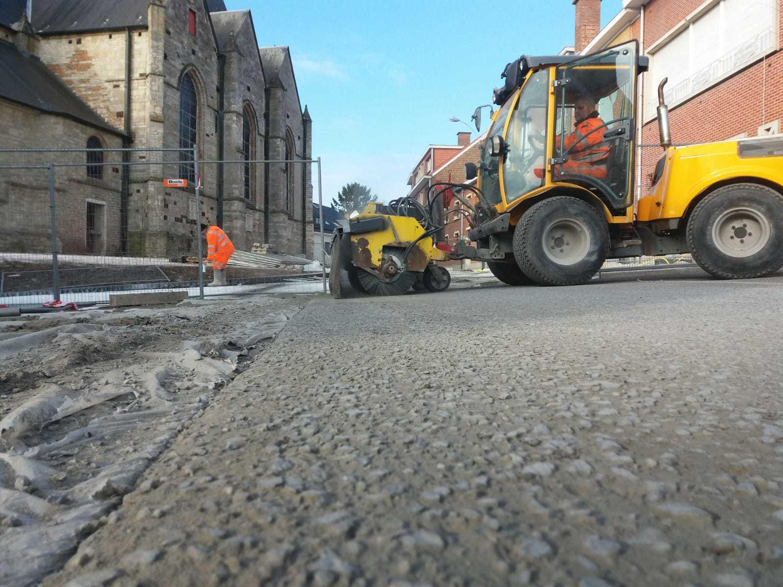 Uitwassen betonverharding in Wemmel